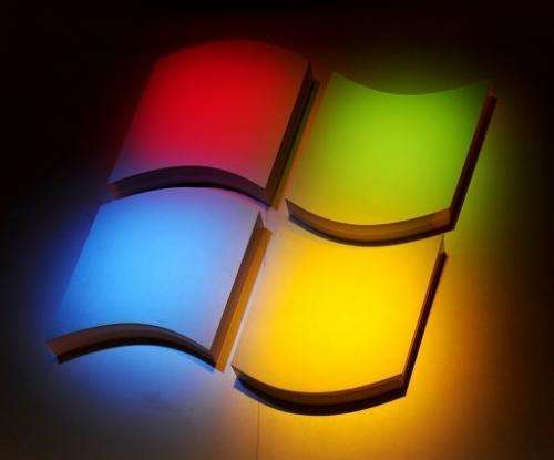 Microsoft said net profit fell 21 percent from the year-ago quarter, to $4.5 billion