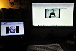 Monitors display the hacked Greek ministry of justice website on February 3