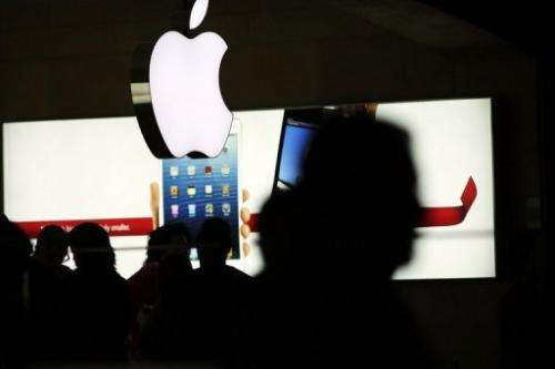 People walk through the Apple retail store in Grand Central Terminal on December 10, 2012 in New York City.