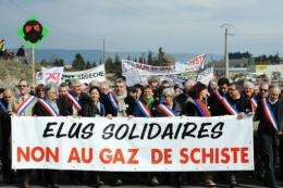 """Protesters hold banner reading: """"In solidarity, no to the shale gas"""" in France in 2011"""