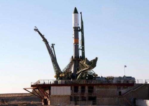 A Russian Soyuz-U booster carrying an unmanned cargo spacecraft Progress