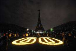 File photo shows the Eiffel Tower in Paris submerged into darkness for Earh Hour in 2010