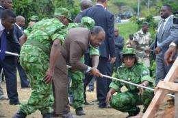 Gabonese President Ali Bongo (C) gets ready to set fire to five tons of ivory worth around 10 million euros