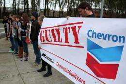 Protestors hold signs during a demonstration outside of the Chevron headquarters in 2011