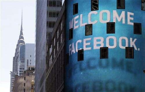 Facebook stock climbs after upgrade
