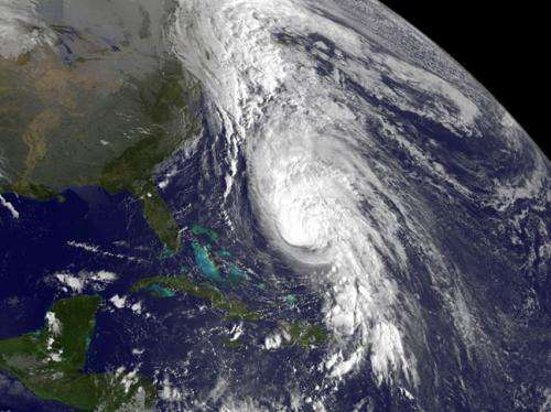Satellite sees large Hurricane Rafael battering Bermuda