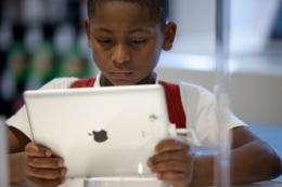 A Brazilian boy looks at an iPad