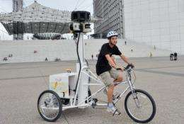 A French student rides a tricycle fitted with cameras as part of the Google Street View project