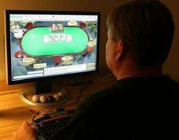 A man plays poker on an Internet gaming site from his home in Manassas, Virginia