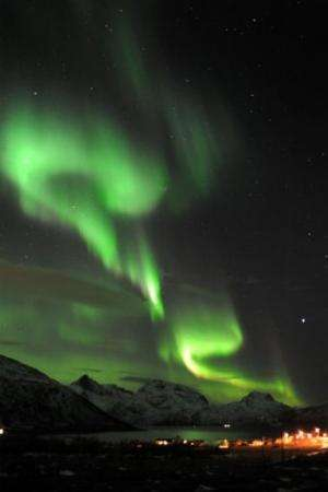 An Aurora borealis is pictured near the city of Tromsoe, northern Norway