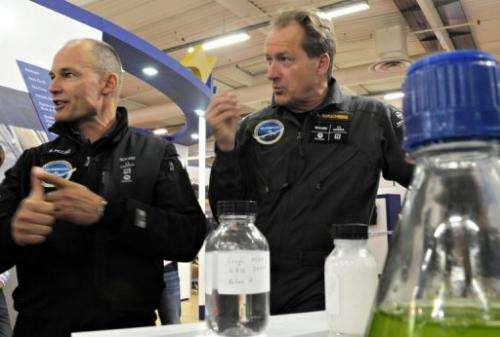Andre Borschberg (R) and joint founder and president of Solar Impulse project Bertrand Piccard in 2011