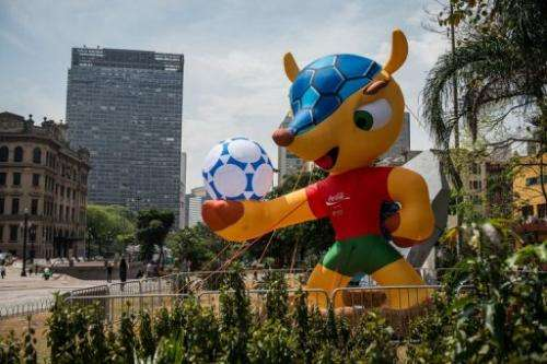"""An inflatable mascot of the FIFA World Cup Brazil 2014, a """"Tatu-bola"""" is displayed in Sao Paulo, Brazil, on September 24, 2012"""