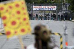 Anti-nuclear demonstrators protest in front of the Garona nuclear plant with a banner in 2011