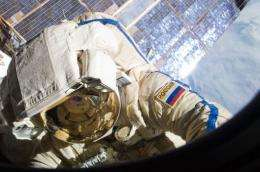 A Russian cosmonaut participates in a session of extravehicular activity on the Russian segment of the ISS
