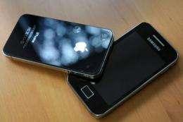 A Samsung phone (R) and an Apple iPhone 4.