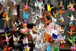 A woman hangs origami in Quezon City, east of Manila, in 2010