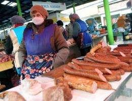 A woman wears a mask on a market in the western Ukrainian city of Lviv in 2009