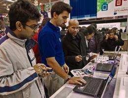Black Friday customers are assisted by a Best Buy worker (C) in the computer department in Fairfax, Virginia in 2011