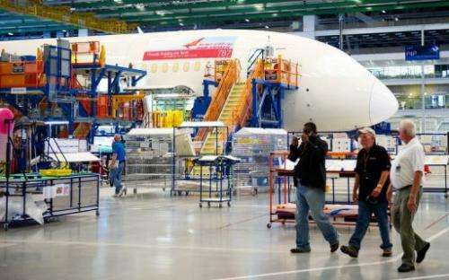 Boeing employees walk by one of Boeing 787 Dreamliners being built for Air India, in North Charlston, South Carolina