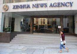 China's official Xinhua news agency plans to list its website by year-end, a report has said