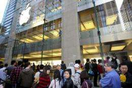Customers line up outside an Apple store in Sydney