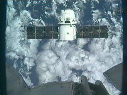 Dragon arrives at space station in historic 1st (AP)