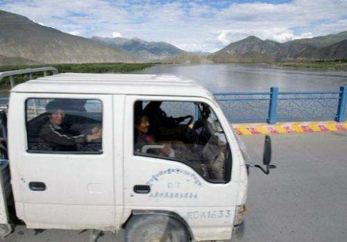 File photo shows a bridge over the Yarlung Tsangpo river in China's southwestern Tibet region