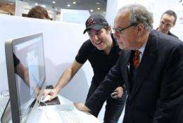 French Culture minister Frederic Mitterrand (R) visits the MIDEM music trade fair