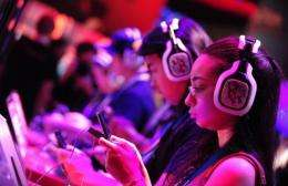 Gaming fans sample new titles and devices at the E3 videogame extravaganza in Los Angeles