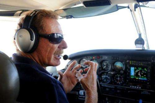 """Gerard Moss talks as he flies the small plane he uses for his """"Rios Voadores"""" (Flying Rivers) project"""