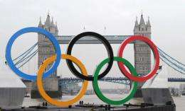Giant Olympic rings are launched on a barge onto the River Thames in London,