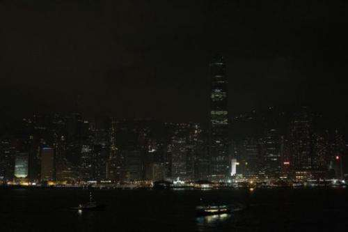 In Hong Kong the city's skyscrapers turned out their lights dimming the usually glittering skyline