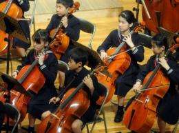 Japan's Princess Aiko (2nd R) plays the cello in the orchestra during the Gakushuin School Corporation's concert