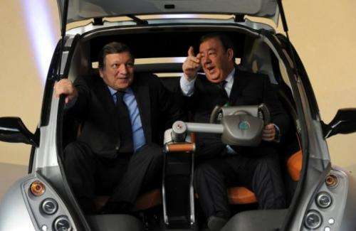 Jose Manuel Barroso (left) helps launch the Hiriko fold-up car in Brussels today
