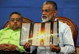 K. Radhakrishnan displays a brochure highlighting ISRO's 100th mission