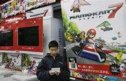 Nintendo posts loss on strong yen, weak sales (AP)