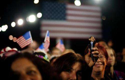Obama supporters cheer as they see poll numbers broadcast on cable news