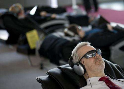 """People get the """"brain light"""" treatment at the world's biggest high-tech fair, the CeBIT"""