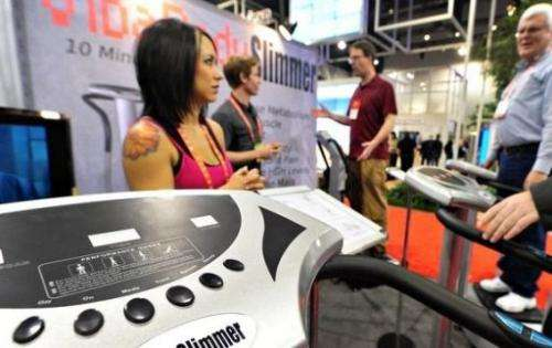 People try out the VibaBody Slimmer exercise machine