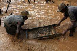 People work at the sapphire mine in Didy, Madagascar