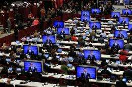 Reporters watch the final minutes of the Presidential Debate