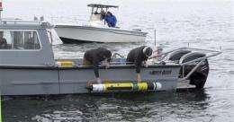 Researchers probe 200-year-old shipwreck off RI (AP)