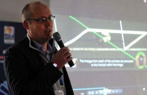 Stephen Carter of Hawk-Eye Innovations explains their goal-line technology at Toyota Stadium in Japan