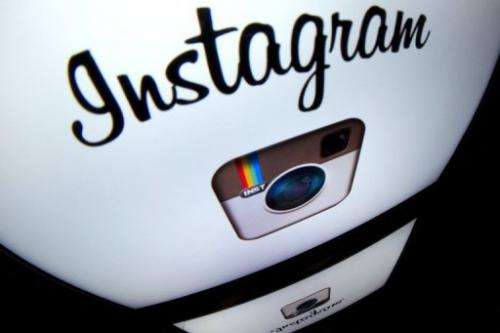 The Instagram logo is displayed on a tablet on December 20, 2012 in Paris