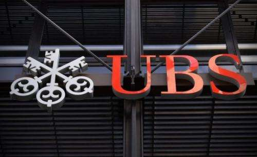 The logo of Swiss bank UBS is pictured outside the company offices in the City of London