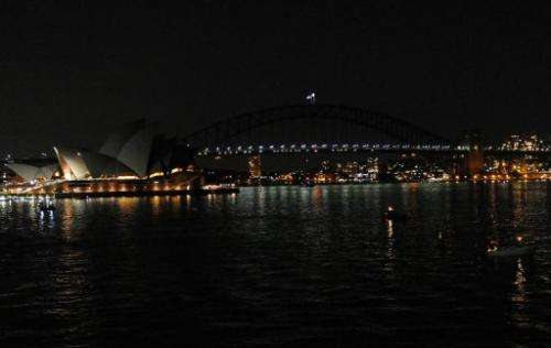The Sydney Opera House and the Sydney Harbour Bridge are darkened at the start of the 6th annual Earth Hour