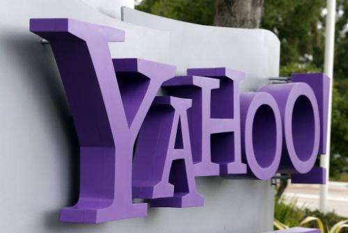 The Yahoo logo is displayed in front of the Yahoo headqarters