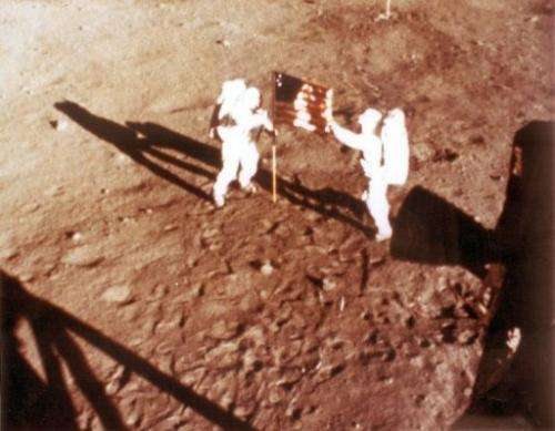"US astronauts Neil Armstrong and ""Buzz"" Aldrin deploy the US flag on the moon in 1969"