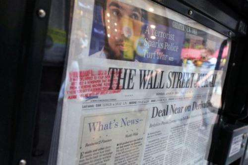 US newspapers gained online readers over the past six months, but not enough to make up for declining print circulation