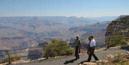 US President Barack Obama and his daughter Malia check out the Grand Canyon in 2009